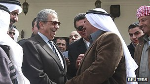 Amr Moussa (2nd left) is greeted by Bedouins during his campaign tour