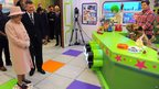 The Queen visits a CBeebies studio and meets Hacker the dog at MediaCityUK in Salford
