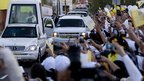 The pontiff waves to faithful from his Popemobile upon his arrival in Leon, Mexico. Photo: 23 March 2012