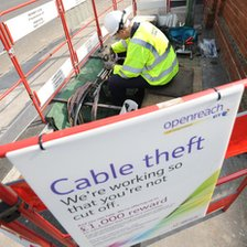 BT worker handling cables