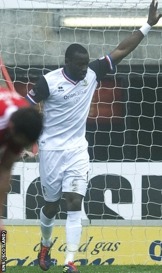 Tade celebrates opening the scoring at Pittodrie