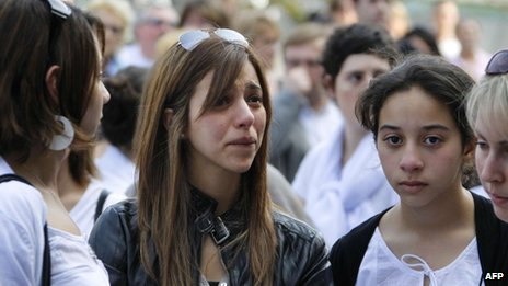 A woman weeps at the silent march for Sgt Imad Ibn Ziaten in Rouen, 24 March
