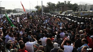 Protesters outside the Egyptian parliament in Cairo (24 March)