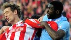 Peter Crouch (left) battles with Man City's Kolo Toure