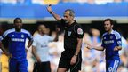 Referee Martin Atkinson waves play on during the match between Chelsea and Tottenham Hotspur at Stamford Bridge