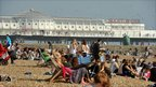 Crowds gather on Brighton beach to enjoy the higher than seasonal temperatures