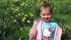 Ula Todeodorska, 2, from Plymouth, plays in the daffodils at Cotehele in Cornwall.