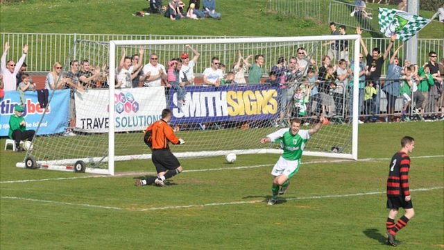 Guernsey FC celebrate scoring against Bedfont Sports