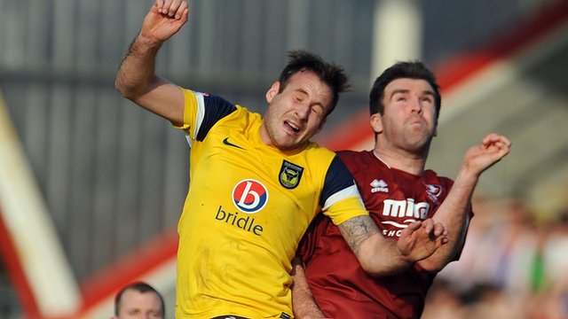 Cheltenham's Ben Burgess and Oxford's Peter Leven battle for the ball