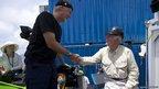 Former US navy lieutenant and deep sea diver Don Walsh greets James Cameron after his dive.