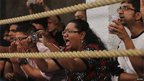 Members of the audience react as they watch a mixed martial arts bout at a fight night in Mumbai - 25 February 2012