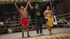 Sangram Bhakre (L), a 21-year-old mixed martial arts fighter, gestures after winning a bout - 25 February 2012