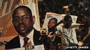 A poster of Macky Sall and his supporters celebrating