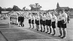 The Great Britain (nearest camera) and Netherlands football teams before their first round match at Highbury Stadium during the London Olympics, 31 July 1948, which GB won 4-3 after extra time