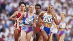 Kelly Holmes of Great Britain (3313) and Svetlana Masterkova (3700) of Russia lead the field in the 1500 metres final during the 1996 Centennial Olympic Games at the Olympic Stadium on 3 August 1996 in Atlanta, USA