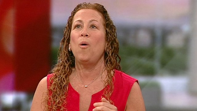 Author Jodi Picoult demonstrates a wolf howl.