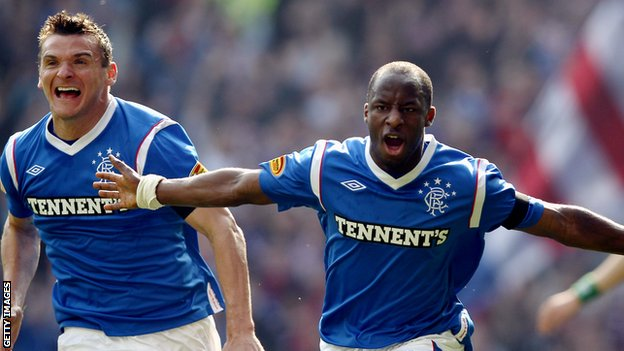 Lee McCulloch and Sone Aluko celebrate at Ibrox
