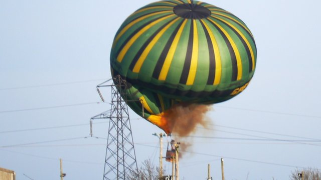 A hot-air balloon crashed into power lines in Northamptonshire