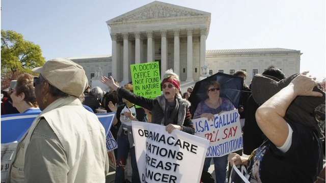 Opponents of the US healthcare law shout slogans at backers of the legislation outside the Supreme Court