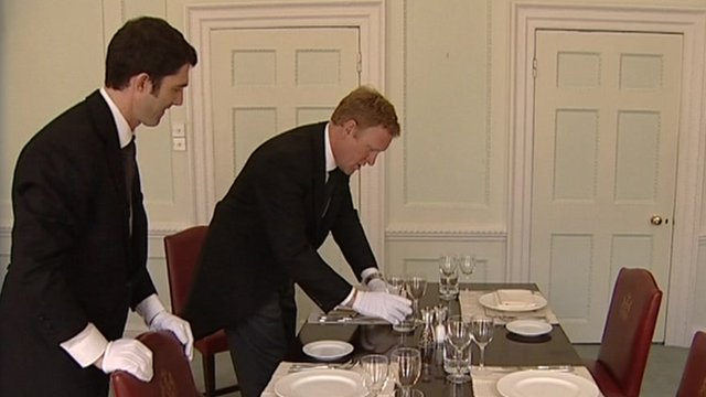John Maguire learning how to set a table properly