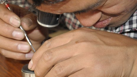 Namgyal working on a watch
