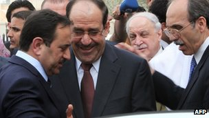 Nouri Maliki (centre) in Baghdad (27 March 2012)
