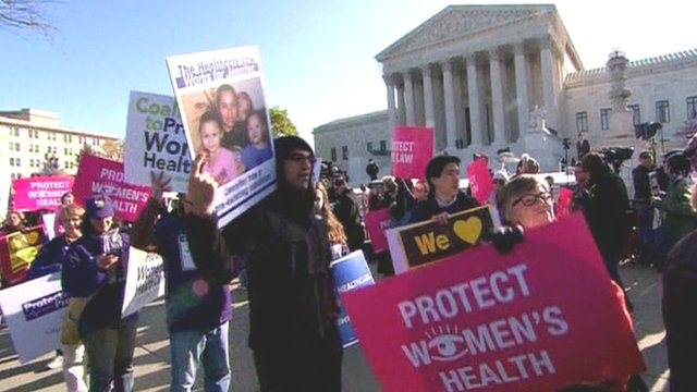Protesters rally outside the US Supreme Court
