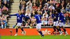 Everton&#039;s Nikica Jelavic (left) celebrates with his team-mates after scoring 