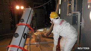 A worker conducts measurements inside the primary containment vessel at Tokyo Electric Power Co. (TEPCO)&#039;s tsunami-crippled Fukushima Daiichi nuclear power plant No 2 reactor