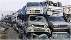 Cars ruined by the earthquake and tsunami are piled up in Ishinomaki, Miyagi prefecture 