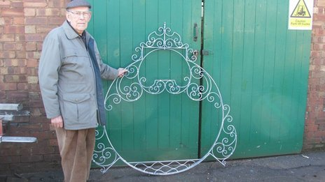 Dennis Pegg with the reclaimed Walberswick village sign