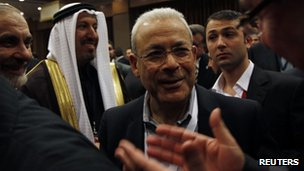Syrian National Council President Burhan Ghalioun (C) is greeted by council members after their meeting in Istanbul March 27 2012