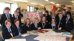 St John Wall School in Birmingham hold up a BBC poster they have made for School Report