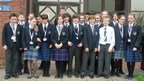 St Bees School in Cumbria stand together for the camera