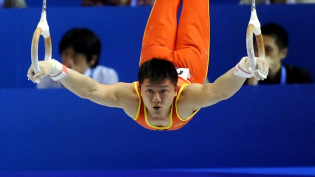 Yibing Chen performing on the rings