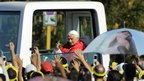 Pope Benedict XVI waves to the crowd while arriving at Revolution Square to officiate a mass in Havana March 28, 2012.