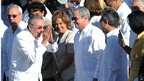 Cuban President Raul Castro (L) greets authorities before Pope Benedict's mass in Revolution Square