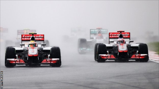 Lewis Hamilton (centre) of Great Britain, McLaren and Jenson Button (right) of Great Britain
