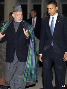 President Barack Obama meets with Afghan President Hamid Karzai, left, at the presidential palace in Kabul, Afghanistan, Sunday, March 28, 2010.