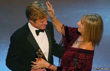 Robert Redford receives his honorary Oscar from Barbra Streisand