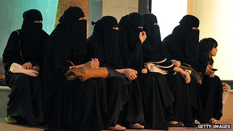 Saudi women waiting for their drivers outside a mall in Riyadh