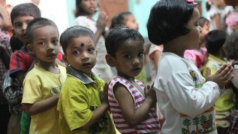 Children attend a worship assembly at Aunab Foundation School, Kidderpore, India