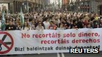 Protesters in Bilbao carry a banner reading &quot;You are not just cutting our money, you are cutting our rights&quot;, 29 March 2012