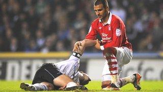 Nottingham Forest's Marcus Tudgay comforts a stricken Shaun Barker
