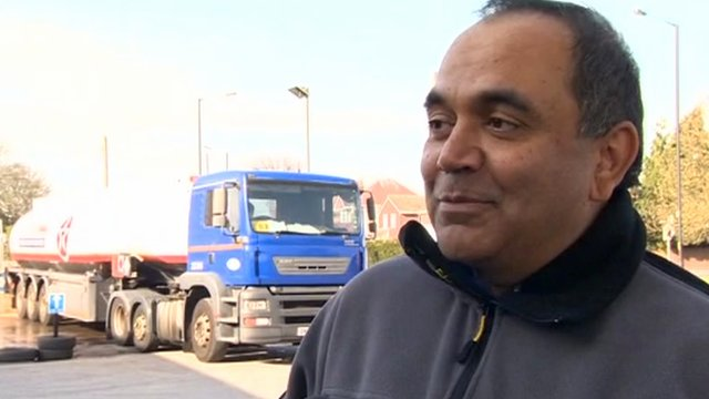 Petrol station owner Shailesh Parekh with tanker in the background