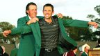Phil Mickelson presents Charl Schwartzel with the famous Green Jacket