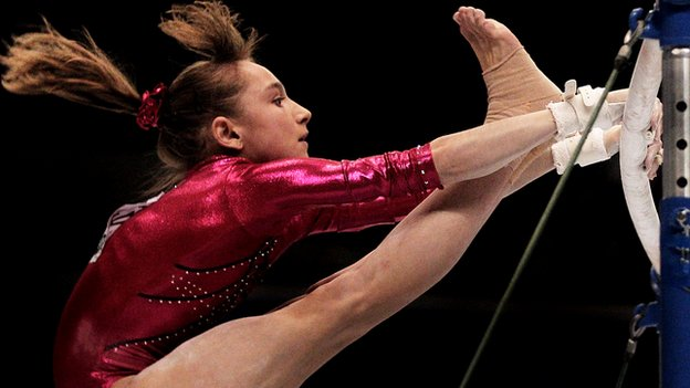 Viktoria Komova on the bars