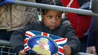 Small child holds a Diamond Jubilee Union flag