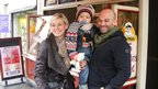Stephanie and Frank Riva with their son, standing in front of their sandwich shop, Le Mitron, in Nancy.
