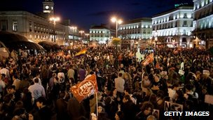 Demonstrators crowd Cibeles Square during a general strike in March 2012 in Madrid.